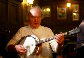 Dessie Mulkere (Clare) playing banjo at Cruises Bar Thurs night seisiún. Photographer Patrick Keating