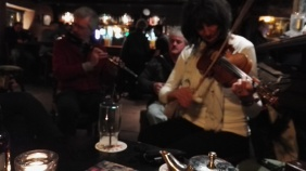 In the background; Brian on flute, Michael on accordion. In the foreground; Betty on fiddle.