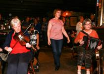 Paula on fiddle, Patricia doing a sean-nós dance and Mary Caldwell on accordion. Photo by Pat Keating.